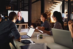 Staff in video conference via TV monitor