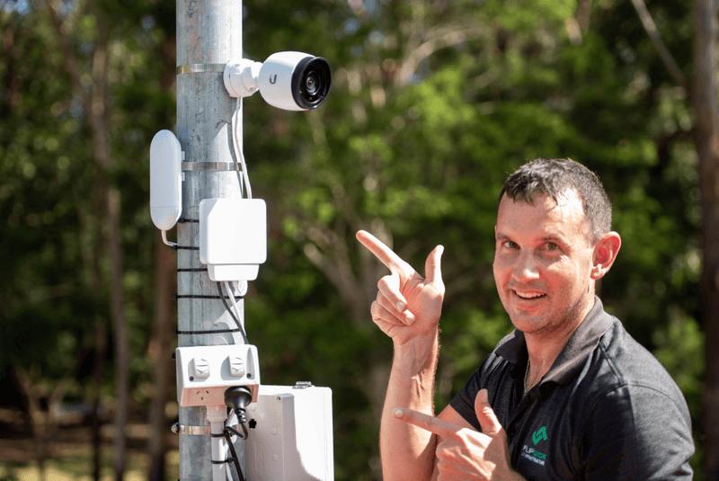 Man pointing at outdoors camera